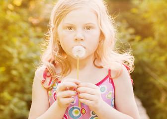 little girl with dandelion outdoor
