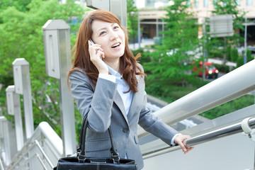 Beautiful business woman walking outside her office. Portrait of