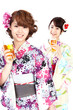 Beautiful kimono women drinking beer