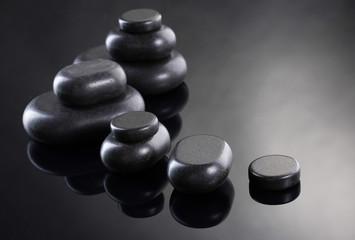 Spa stones on grey background