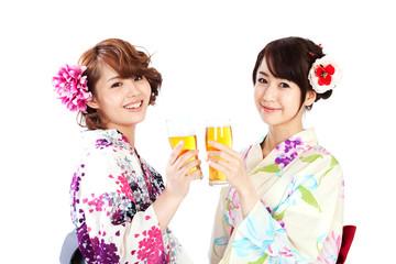 Beautiful kimono women drinking beer