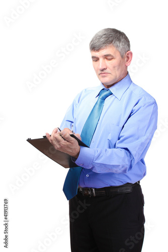 Businessman writing on document isolated on white