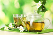 green tea with jasmine in cup and teapot
