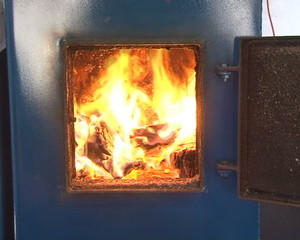 boiler fired with wood and pellets. burning fire warming house