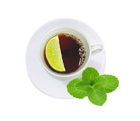 cup of tea with mint leaves and lime slice isolated on white