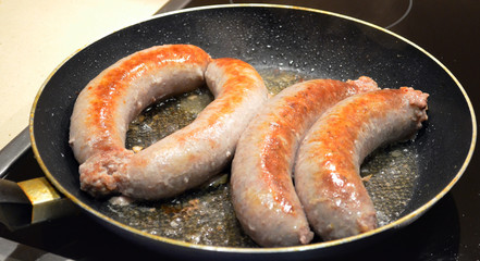 Hose packed meat baking pan. Fatty pork sausages