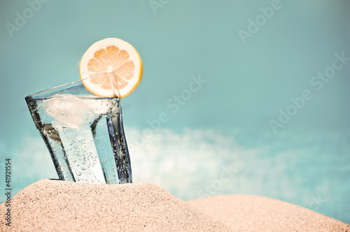 Cold drink on the beach on a hot summer day