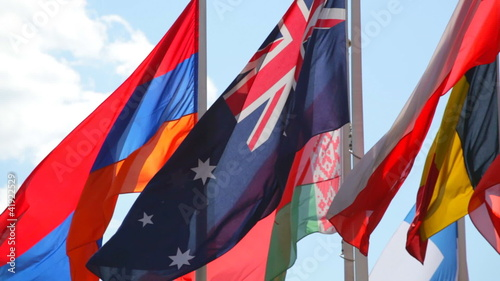 Flags of the different countries on  background of  blue sky