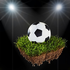 soccer ball on a piece of sod