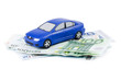 The toy car for euro banknotes isolated