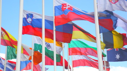 Flags of the countries of  World on a background of  blue sky