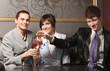 A businessteam celebrating in a restaurant