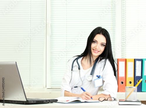 beautiful girl doctor in the office