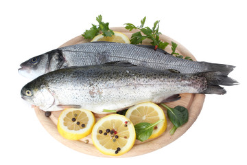 Fresh fishes with lemon, parsley and spice