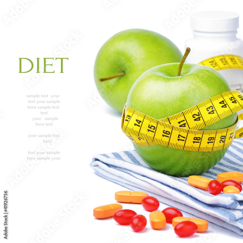 Green apples, vitamins and measuring tape