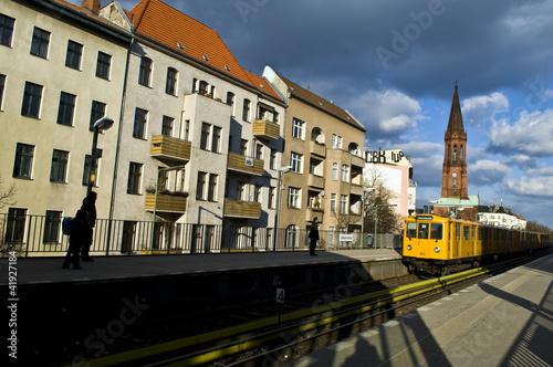 a metro train reaches gorlitzer station, berlin, germany