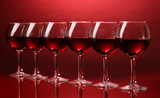 Wineglasses on red background - 41927927