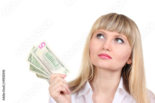 Business woman holding money isolated on white