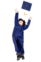 Boy throwing mortarboard
