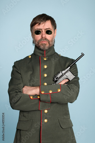 man military officer with a gun