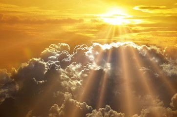 Dramatic impressive background - sky with bright sun and dark cl