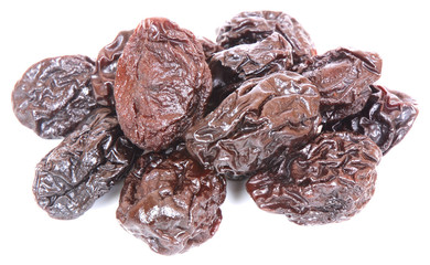 Dried prunes on white