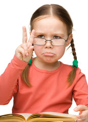 """Sad little girl showing """"Victory"""" gesture"""