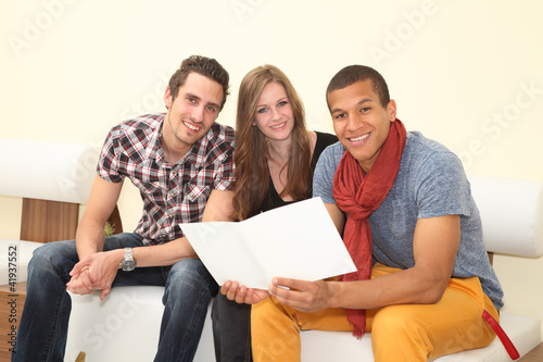 friends reading a brochure