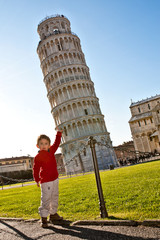 Boy sustains Pisa tower optical effect