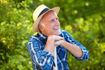 Senior gardener, happy