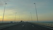 Driving  car in highway at sunset