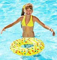 Little girl in swimming pool.