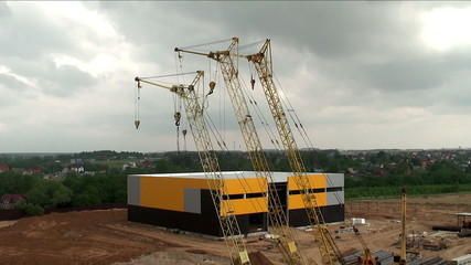 Building cranes on a construction site