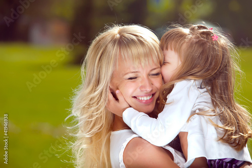 Beautiful happy mother with her daughter outdoors