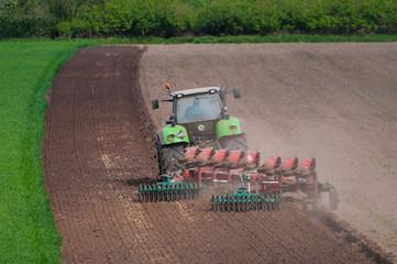 farmer ploughing field