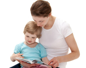 Young mother reading a book for little daughter