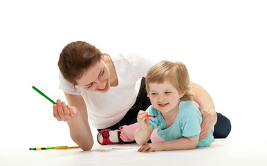 Happy young mother and her daughter drawing