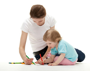 Young mother drawing with her little daughter