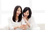 Beautiful young women using a moblie phone