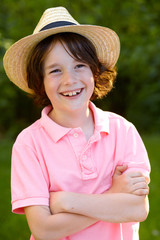 portrait of young sweet boy with straw hat 3