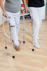 Woman With Walker And Trainer
