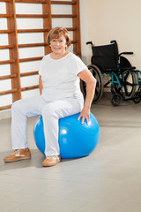 Senior Woman Sitting On Fitness Ball