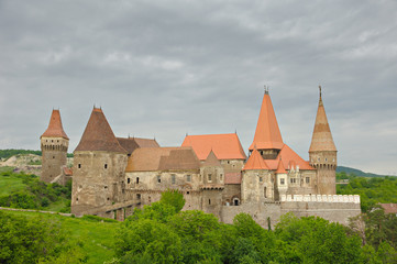 view of Huniad Castle (built 1315) on a cloudy day