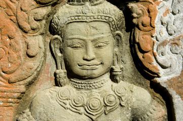 an apsara statue in a temple, cambodia