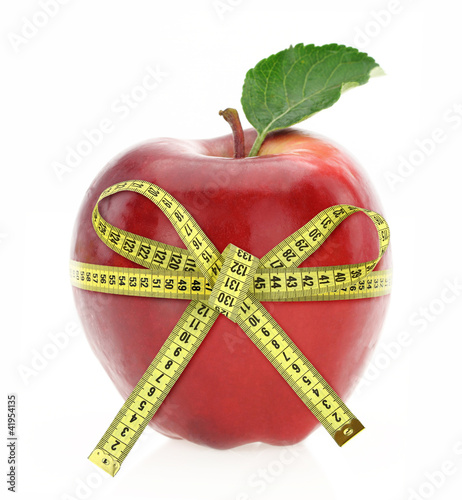 Diet Diabetes Weight Loss Concept With Tape Measure Organic Green Apple And Pink Dumbbels On A White Background. Стоковая фотогр