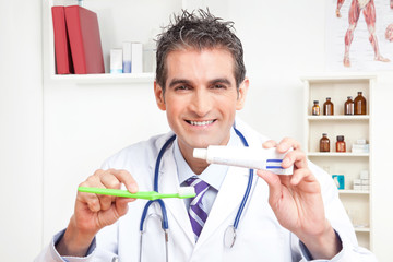 Doctor Holding  Tooth Brush and Toothpaste