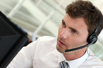 Portrait of salesman with headset on