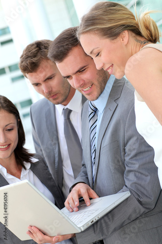 Business team consulting program on laptop