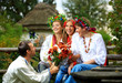 Young people in Ukrainian clothes flirting