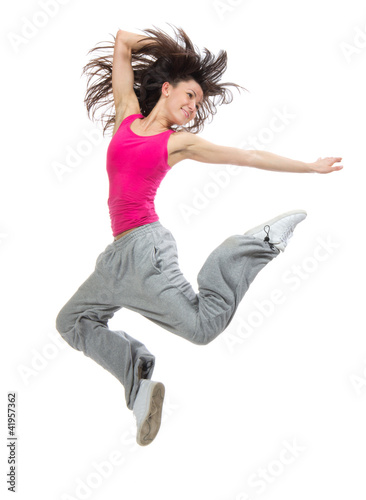 modern slim hip-hop style teenage girl jumping dancing